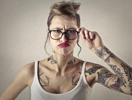 失望の刺青の女の子 写真素材
