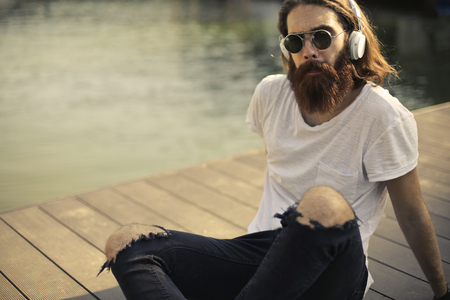 Hipster listening to music Stock Photo