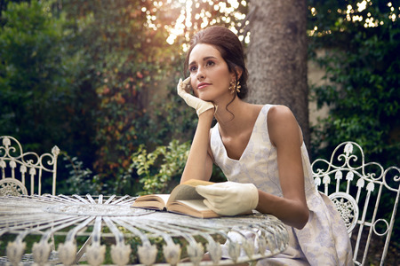 Daydreaming lady in white Imagens