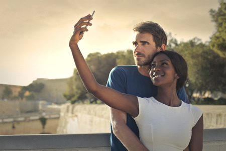 black couple: Couple doing a selfie