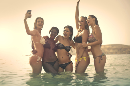 sun beach: Group of girls having fun in the water