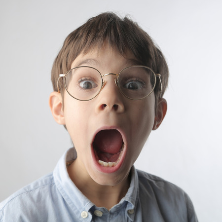 surprise face: Spellbound kid Stock Photo