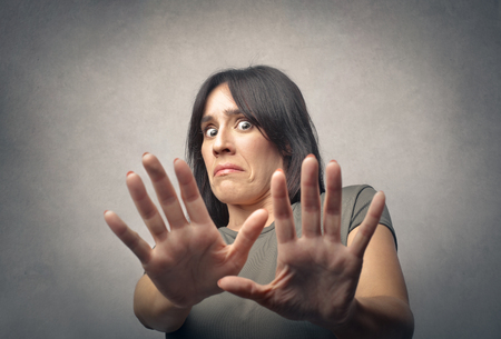 disgusted: Scared and disgusted woman Stock Photo
