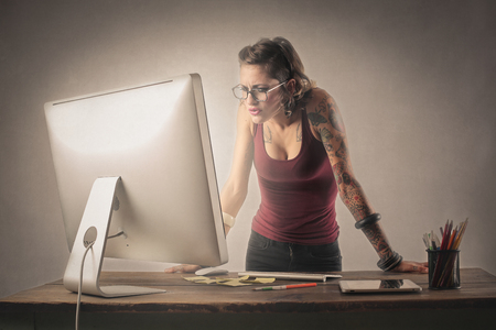 Creative woman working at her desk 스톡 콘텐츠