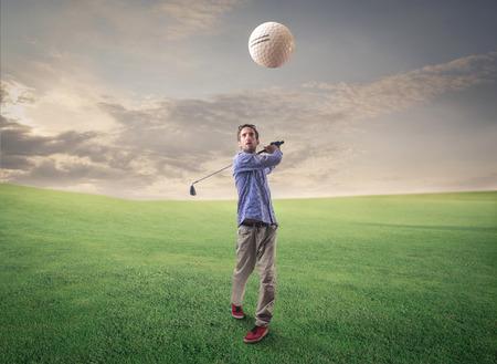 playing golf: Playing golf