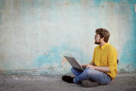 man profile: Nerd using his laptop
