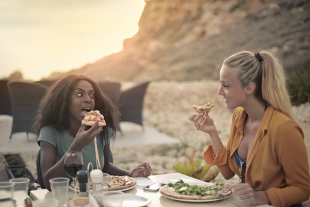 Eating a tasty food at the beach Stock Photo
