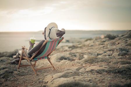 relaxing beach: Sitting in a beach chair