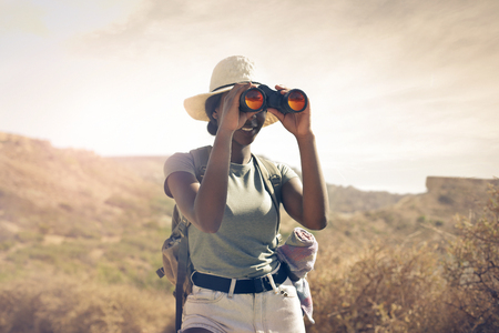 using binoculars: Explorer using binoculars Stock Photo