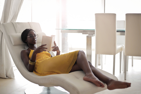 beautiful black woman: Relax on a chaise longue Stock Photo