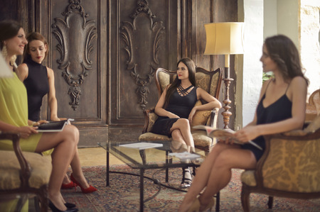 Women sitting in the hotel room