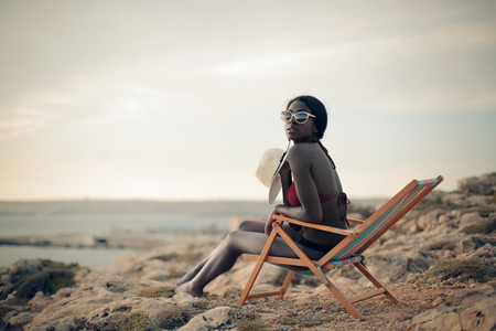 Woman sitting in a beach chair