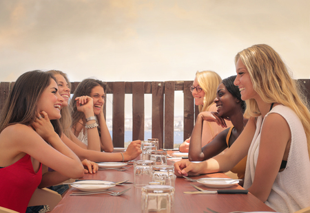 joking: Young women having lunch together