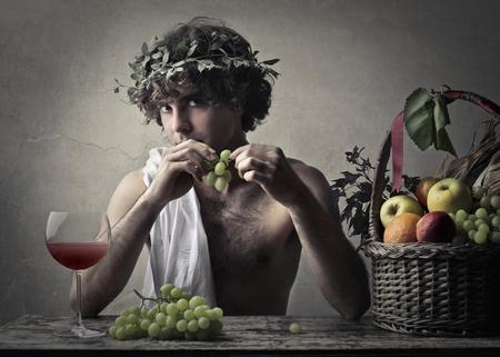 bacchus: Bacchus holding grapes Stock Photo