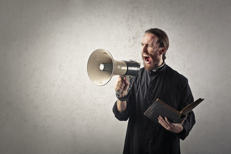 strong message: Priest delivering a strong message Stock Photo