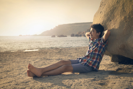 Relaxed kid at the beach photo