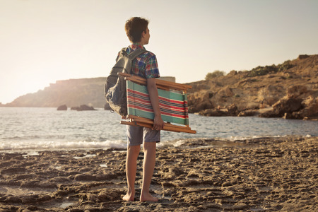 Young boy heading to the beach photo