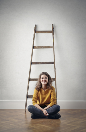 home: Girl is sitting next to the ladder