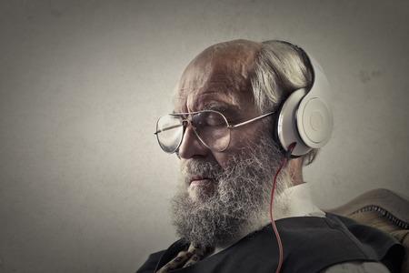 Old man in headphones