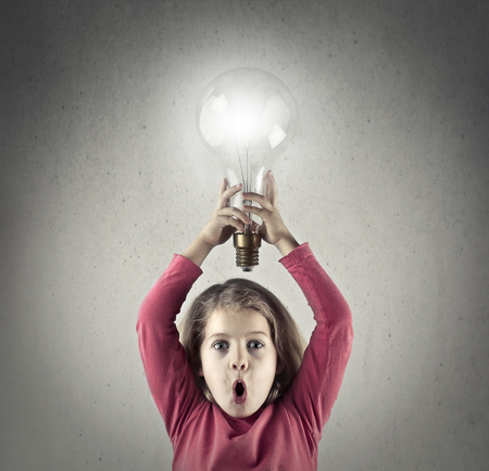A little child and a big lightbulb