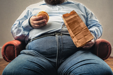 junky: Obese man is eating fast food