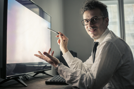 work from home: businessman is pointing at the screen