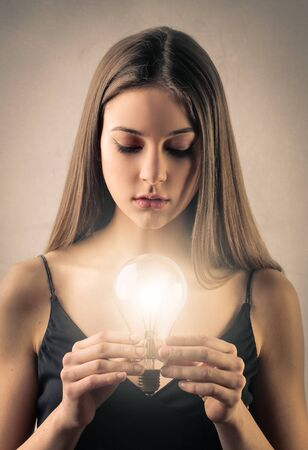 Girl with a lightbulb