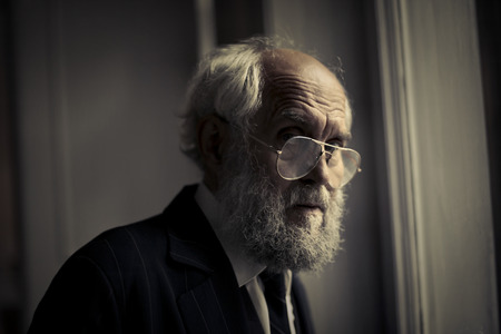 shadow man: Old man in a suit with glasses
