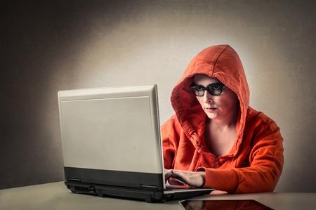 A hacker in a hood Stock Photo