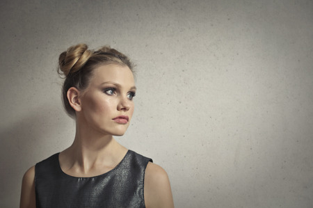blonde teenager: Woman in a grey dress Stock Photo