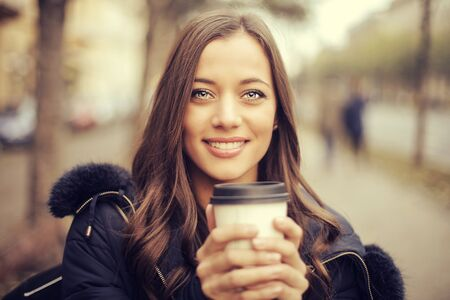 cold: beautiful lady has a tea in the cold Stock Photo