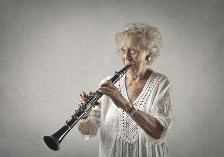 Grandma is playing on a clarinet