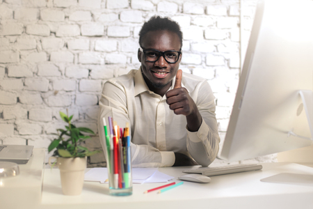thumbup: Black businessman with a thumb-up Stock Photo