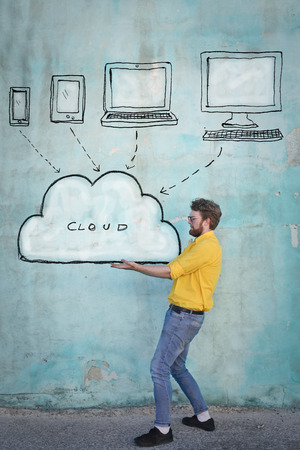 Man is holding a cloud Imagens