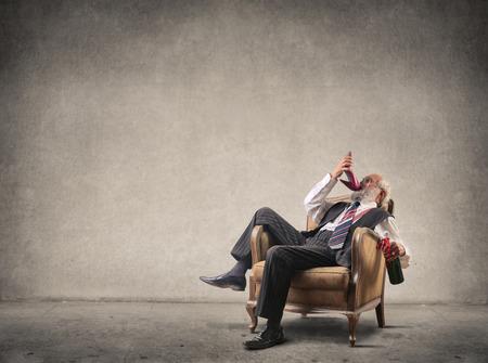 Drunk man in an old airchair photo