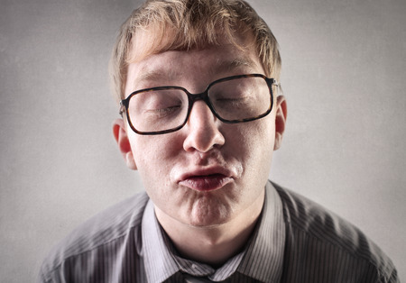 Nerd in glasses gives a kiss