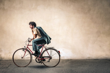 copyspace: Businessman is riding a bike