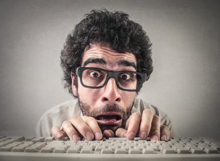 Crazy man is typing Reklamní fotografie - 75704322