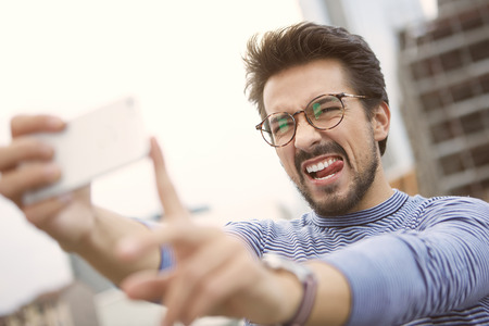 Taking a funny selfie photo