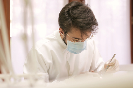 study: Young dentist is working Stock Photo