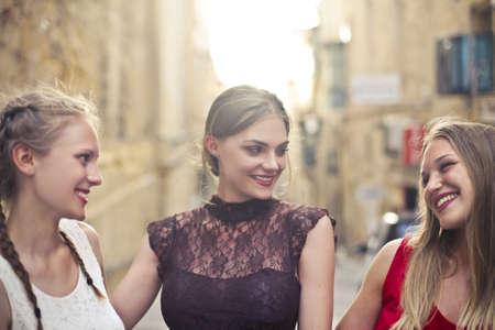 Three beautiful friend in the city photo