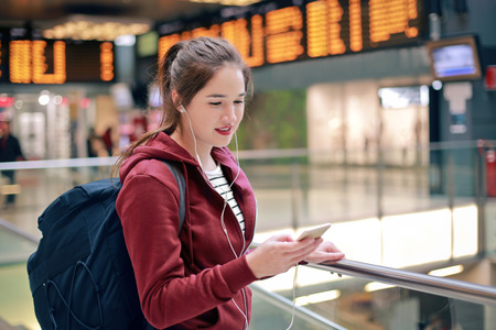 lady on phone: Young girl at the railway station