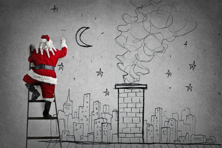 grey: Santa is also drawing on the wall of the city Stock Photo