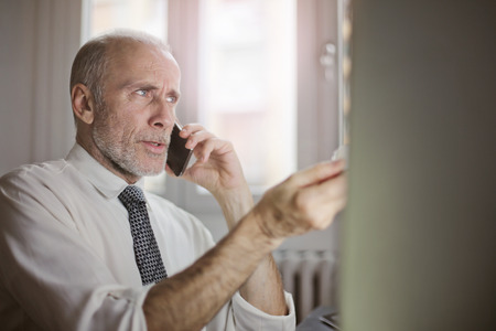 mobile: If the boss is having a phonecall Stock Photo
