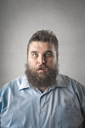 large: Fat guy is shocked Stock Photo