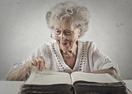 book: Old lady is reading a big book