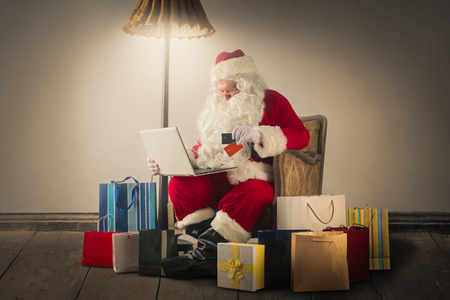christmas gift: Santa Claus with a laptop Stock Photo