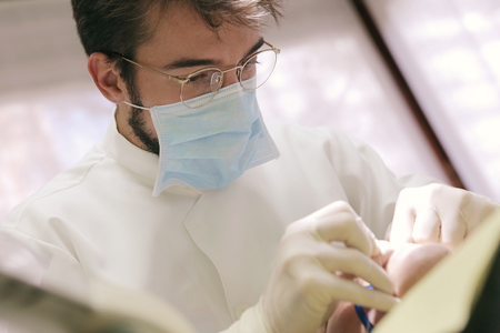 white work: Dentist is taking care of his patient