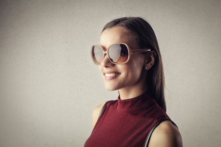 Young lady in sunglasses photo