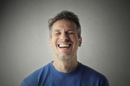 Man laughing too hard photo